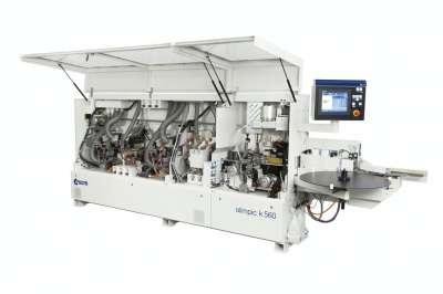 A képen az scm olimpic k 560 típusú automata élzárógép látható nyitott állapotban.